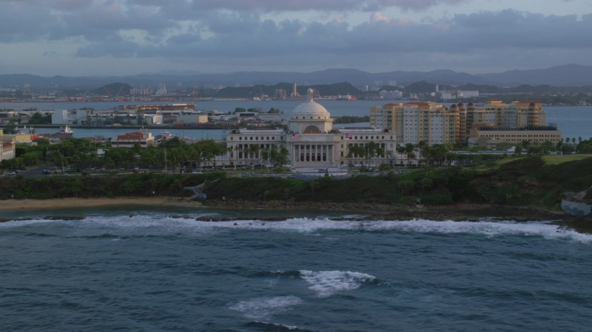 5k stock footage aerial video of San Juan Capitol Building along the coast, Old San Juan, Puerto Rico, sunset Aerial Stock Footage | AX104_050