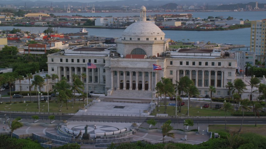 5k stock footage aerial video Tilting down on San Juan Capitol Building, Old San Juan, Puerto Rico, sunset Aerial Stock Footage | AX104_052