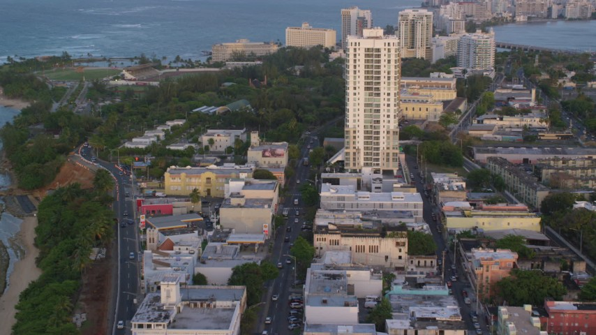 5k stock footage aerial video of Avenida Juan Ponce de Leon and office buildings, Old San Juan, Puerto Rico, sunset Aerial Stock Footage | AX104_055