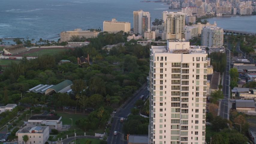 5k stock footage aerial video of Oceanside hotels, office buildings and condo complexes, Old San Juan, Puerto Rico, sunset Aerial Stock Footage | AX104_056