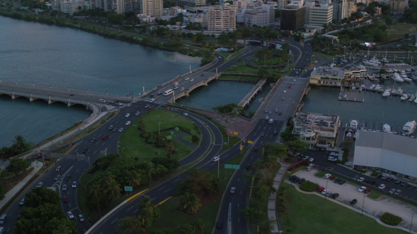 5k aerial video of Light traffic on bridges in the Caribbean, San Juan, Puerto Rico, sunset Aerial Stock Footage | AX104_059