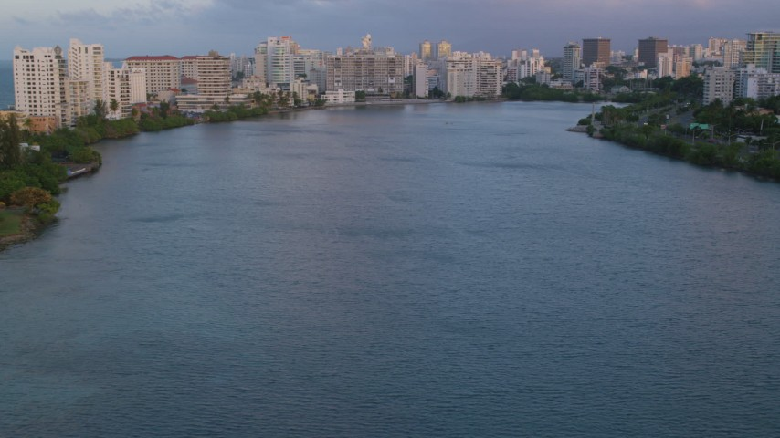 5k stock footage aerial video of hotels along Condado Lagoon, San Juan, Puerto Rico sunset Aerial Stock Footage | AX104_060