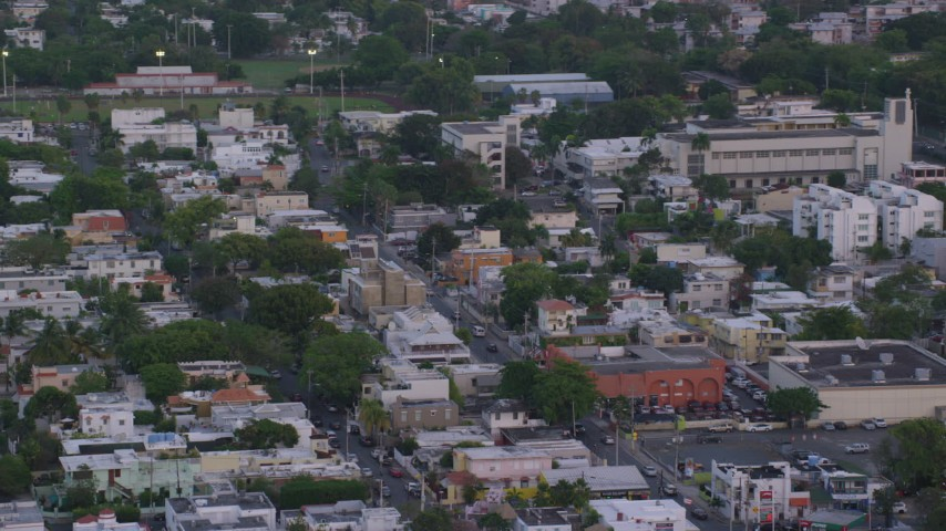 5k aerial video of Residential apartments and businesses, San Juan, Puerto Rico, sunset Aerial Stock Footage | AX104_067