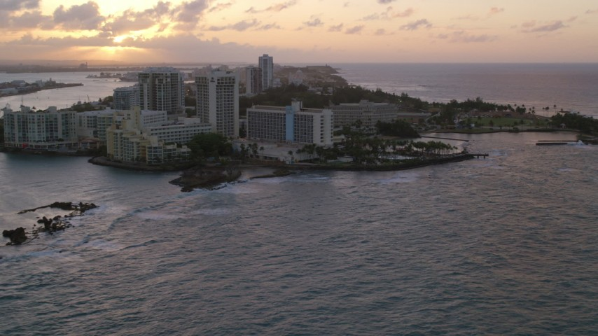 5k stock footage aerial video of the Oceanfront Caribe Hilton Hotel, Normandie Hotel, San Juan, Puerto Rico, sunset Aerial Stock Footage | AX104_072
