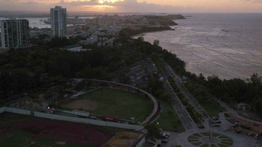 5k stock footage aerial video of Beachfront, oceanfront buildings, Old San Juan, Puerto Rico, sunset Aerial Stock Footage | AX104_074