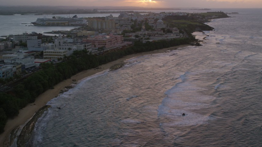 5k stock footage aerial video Approaching San Juan Capitol Building along the coast, Puerto Rico, sunset Aerial Stock Footage | AX104_076