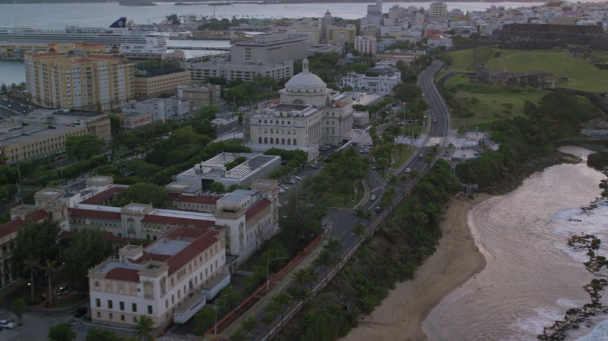 5k stock footage aerial video of San Juan Capitol Building along the coast, Puerto Rico, sunset Aerial Stock Footage | AX104_077