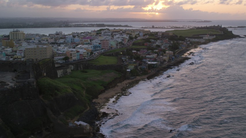 5k stock footage aerial video of Oceanfront Caribbean homes, Old San Juan, Puerto Rico, sunset Aerial Stock Footage | AX104_078