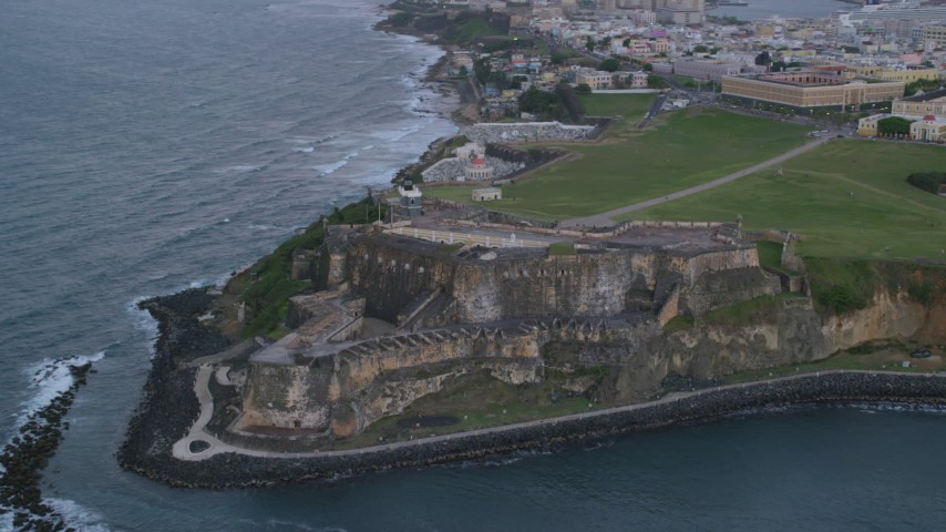 5k stock footage aerial video of Fort San Felipe del Morro, Old San Juan, twilight Aerial Stock Footage | AX104_089