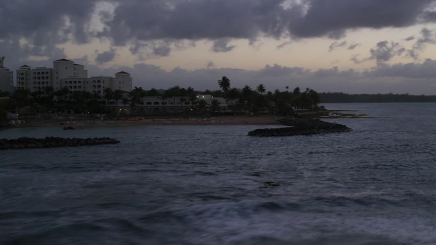 5k stock footage aerial video of a Caribbean hotel on the coast along ocean waters, Dorado, Puerto Rico, twilight Aerial Stock Footage | AX104_109