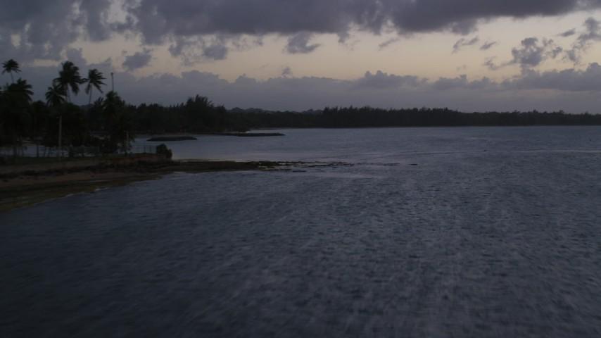 5k stock footage aerial video of the Caribbean coastline along ocean waters, Dorado, Puerto Rico, twilight Aerial Stock Footage | AX104_110