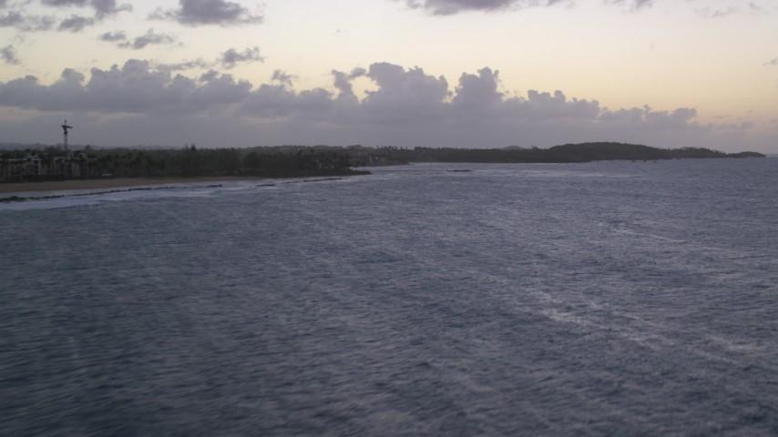 5k stock footage aerial video Flyover ocean along a Caribbean beach, Dorado, Puerto Rico, twilight Aerial Stock Footage | AX104_114