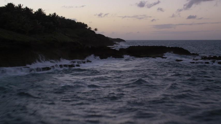 5k stock footage aerial video of the Rugged Caribbean coast along the ocean, Dorado, Puerto Rico, twilight Aerial Stock Footage | AX104_118