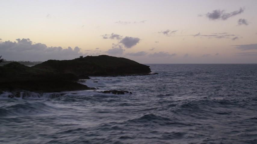 5k stock footage aerial video of the Ocean along rugged Caribbean coast, Dorado, Puerto Rico, twilight Aerial Stock Footage | AX104_120