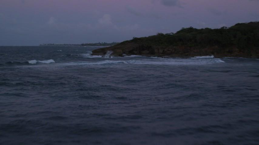 5k stock footage aerial video of Ocean waters along rugged Caribbean shore, Dorado, Puerto Rico, twilight Aerial Stock Footage | AX104_128