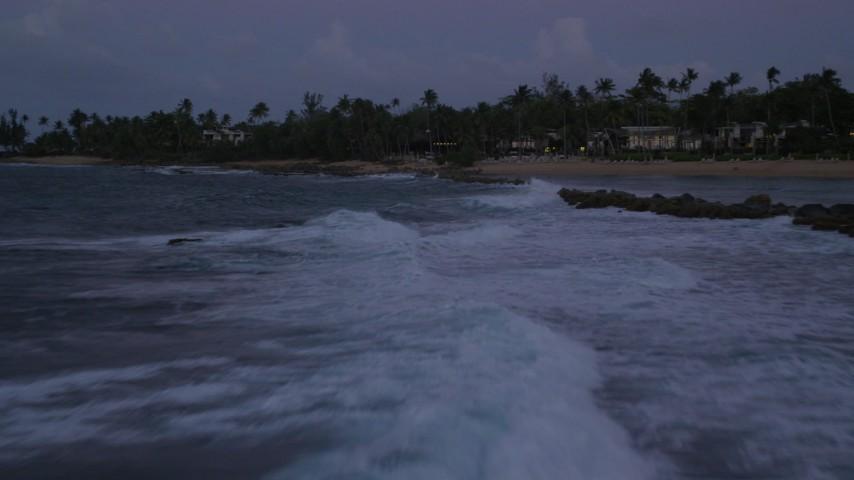 5k stock footage aerial video of Breakwaters along Caribbean waters, Dorado, Puerto Rico, twilight Aerial Stock Footage | AX104_133