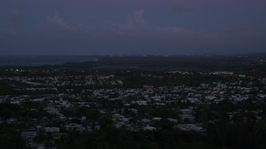 5k stock footage aerial video of Caribbean neighborhoods along the coast, Dorado, Puerto Rico, sunset Aerial Stock Footage | AX104_136