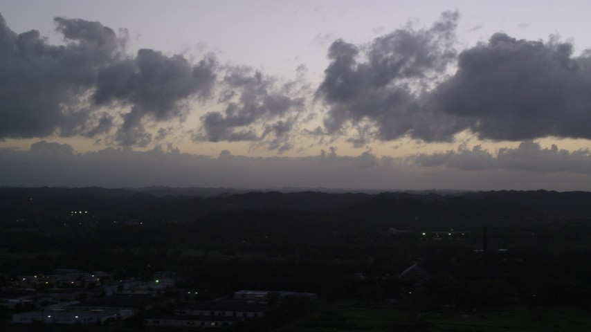 5k stock footage aerial video of Clouds over a Caribbean town, Dorado, Puerto Rico, twilight Aerial Stock Footage | AX104_137