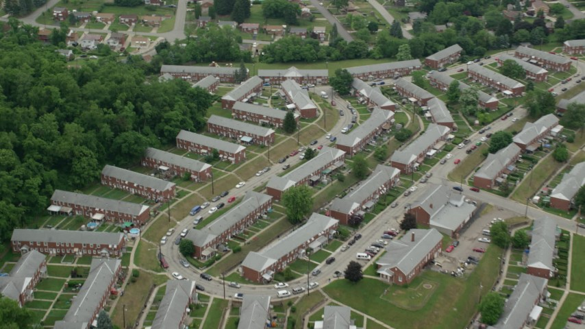 5K stock footage aerial video flying over row houses, Munhall, Pennsylvania Aerial Stock Footage | AX105_025