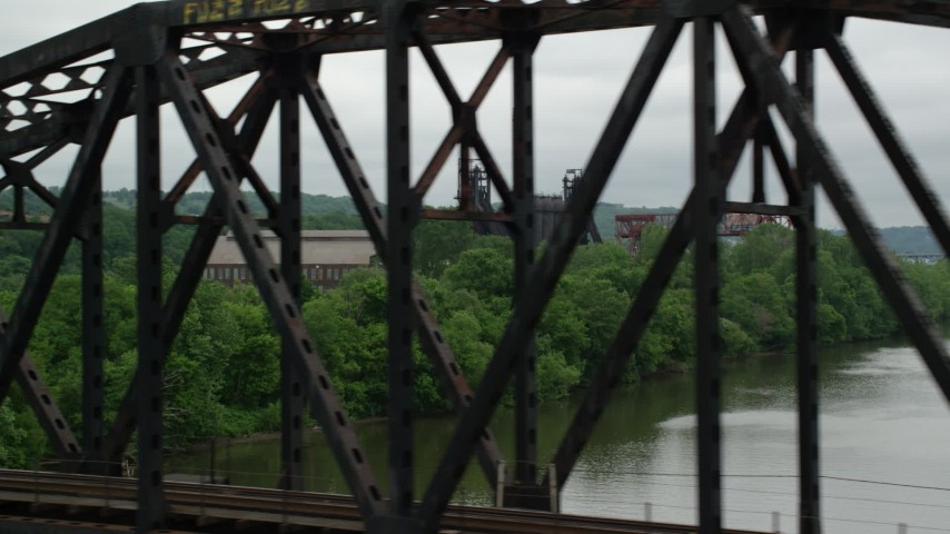 5K stock footage aerial video of Railroad Bridge and Factory, Carrie Furnace, Pittsburgh, Pennsylvania Aerial Stock Footage | AX105_034
