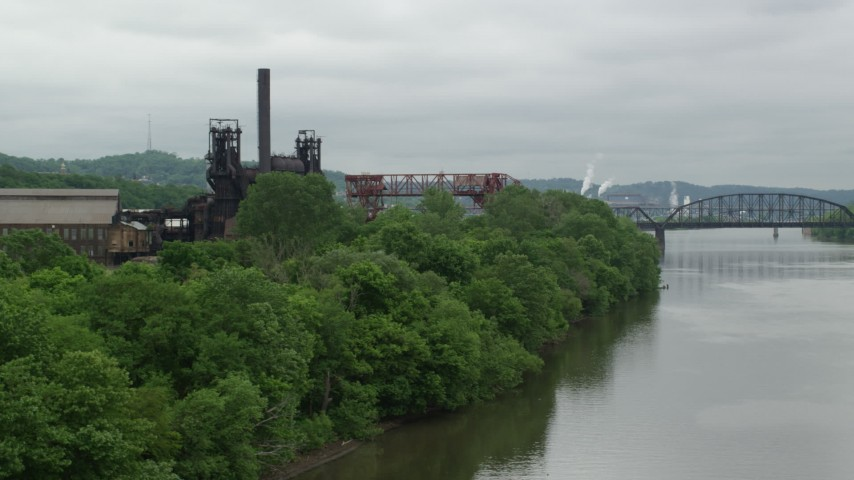 5K stock footage aerial video of Waterfront Factory, Carrie Furnace, Pittsburgh, Pennsylvania Aerial Stock Footage | AX105_035