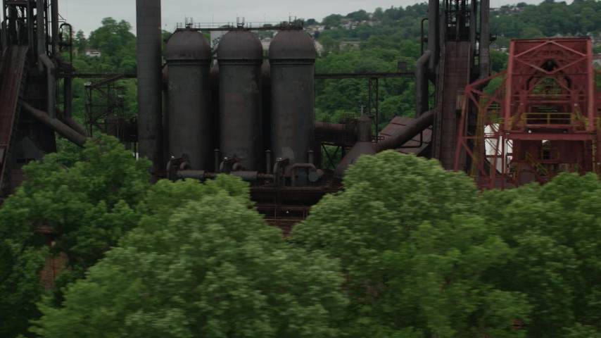 5K stock footage aerial video orbiting historic steel factory, Carrie Furnace, Pittsburgh, Pennsylvania Aerial Stock Footage | AX105_038