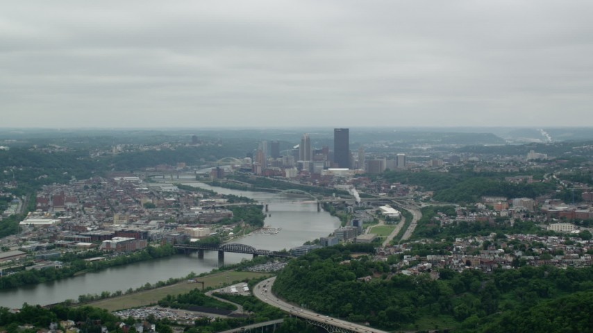 5K stock footage aerial video approaching river and skyscrapers, Downtown Pittsburgh, Pennsylvania Aerial Stock Footage | AX105_076