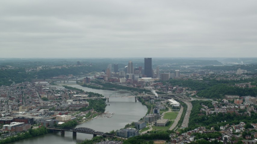 5K stock footage aerial video following river to downtown skyscrapers, Downtown Pittsburgh, Pennsylvania Aerial Stock Footage | AX105_077