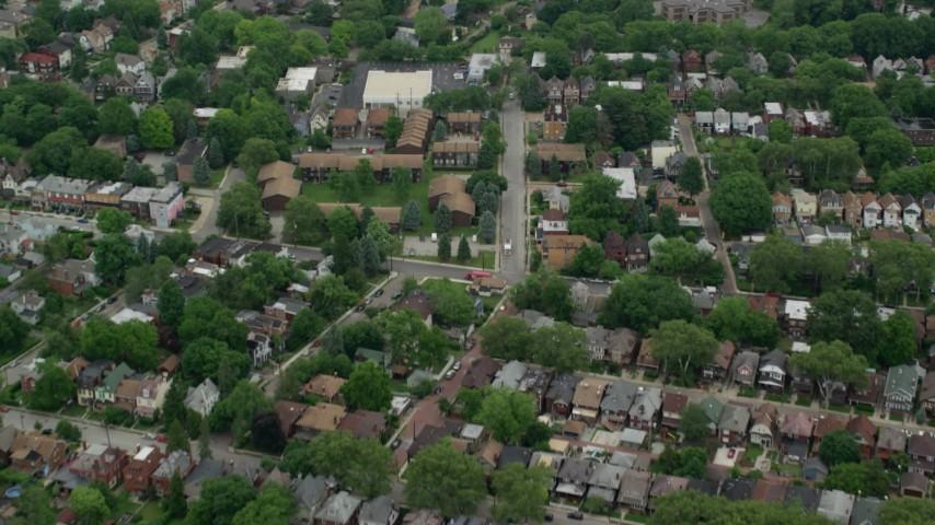 5K stock footage aerial video flying over tree-lined suburban neighborhoods, Pittsburgh, Pennsylvania Aerial Stock Footage | AX105_083