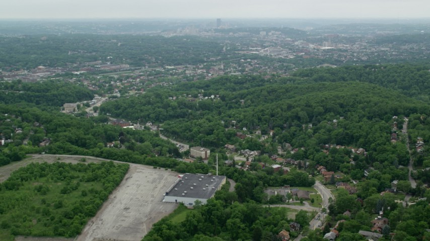 5K stock footage aerial video of green hills and suburbs, Pittsburgh, Pennsylvania Aerial Stock Footage | AX105_100