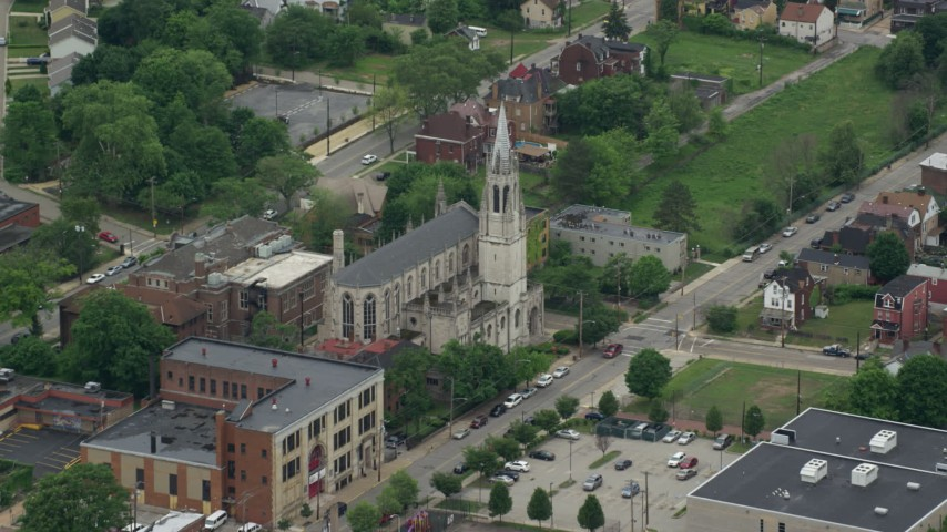 5K stock footage aerial video approaching cathedral with steeple, Pittsburgh, Pennsylvania Aerial Stock Footage | AX105_102