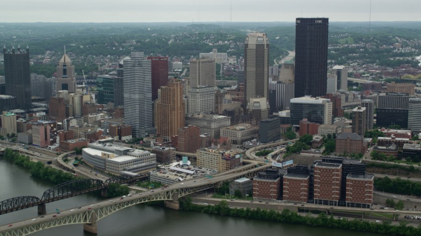 5K stock footage aerial video orbiting Skyscrapers near river, Downtown Pittsburgh, Pennsylvania Aerial Stock Footage | AX105_112