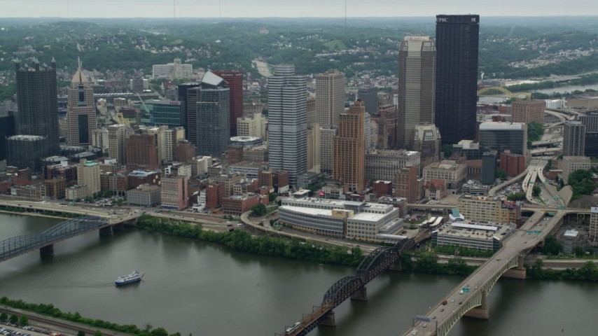 5K stock footage aerial video of skyscrapers across a river, Downtown Pittsburgh, Pennsylvania Aerial Stock Footage | AX105_113