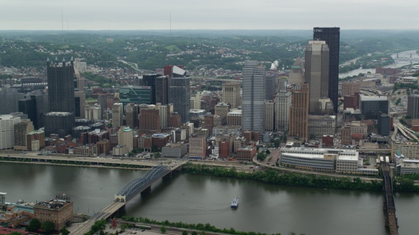 5K aerial video orbiting skyscrapers across the river, Downtown Pittsburgh, Pennsylvania Aerial Stock Footage | AX105_114