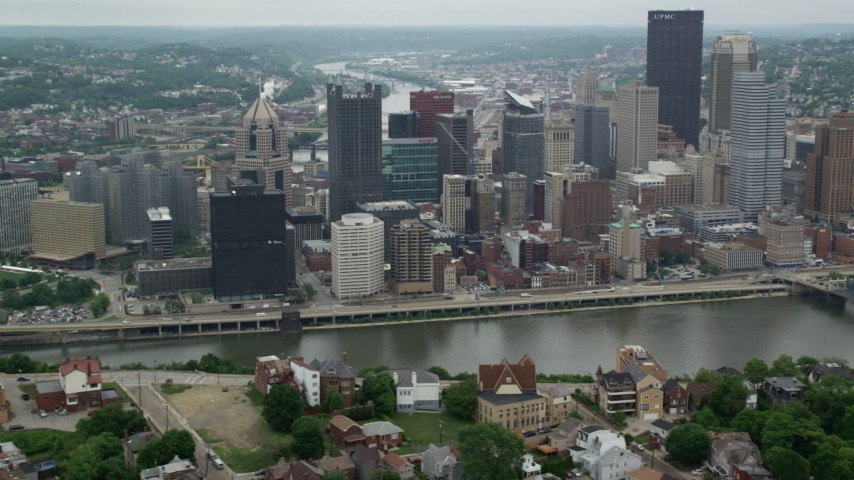 5K stock footage aerial video of riverfront skyscrapers, Downtown Pittsburgh, Pennsylvania Aerial Stock Footage | AX105_116