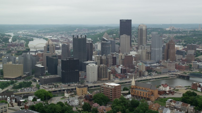 5K stock footage aerial video orbiting riverfront skyscrapers, Downtown Pittsburgh, Pennsylvania Aerial Stock Footage | AX105_117