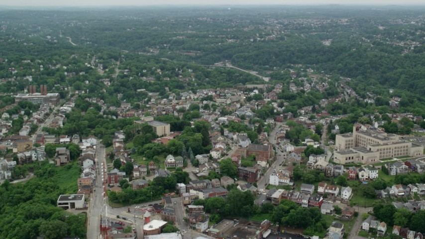 5K stock footage aerial video flying over and tilting up over suburbs, Pittsburgh, Pennsylvania Aerial Stock Footage | AX105_132