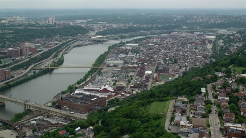 5K stock footage aerial video of a riverfront urban neighborhood, Pittsburgh, Pennsylvania Aerial Stock Footage | AX105_133