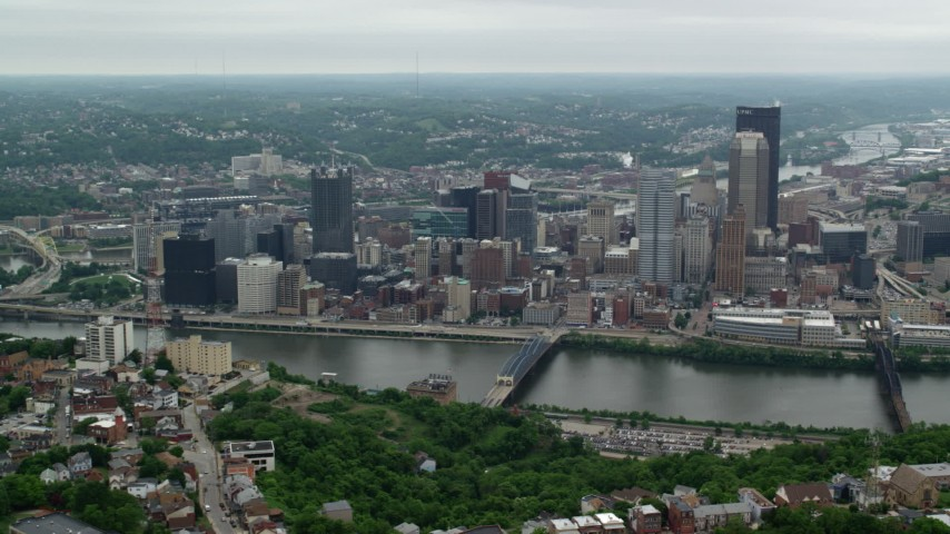5K stock footage aerial video approaching riverfront skyscrapers, Downtown Pittsburgh, Pennsylvania Aerial Stock Footage | AX105_134