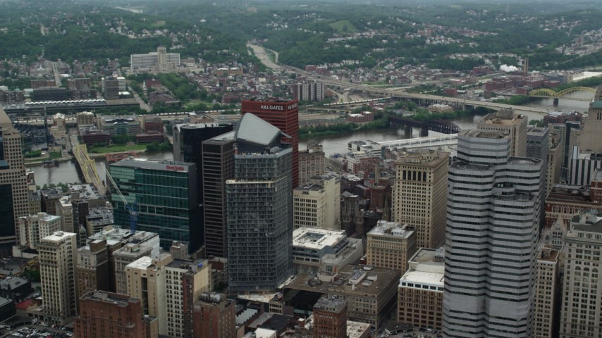 5K stock footage aerial video flying over skyscrapers, approaching river, Downtown Pittsburgh, Pennsylvania Aerial Stock Footage | AX105_137