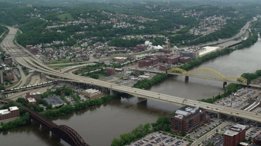 5K stock footage aerial video flying over bridges toward HJ Heinz Plant, Pittsburgh, Pennsylvania Aerial Stock Footage | AX105_139