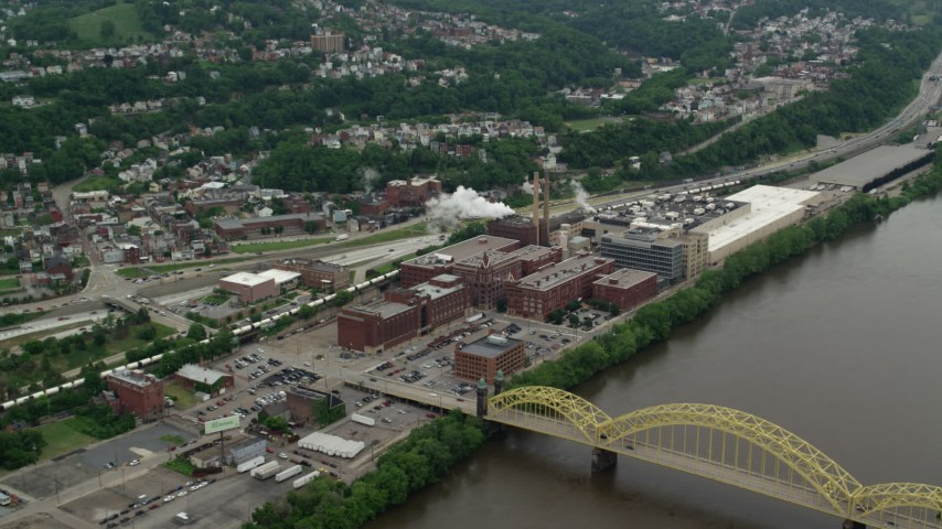 5K stock footage aerial video approaching HJ Heinz Plant, Pittsburgh, Pennsylvania Aerial Stock Footage | AX105_140
