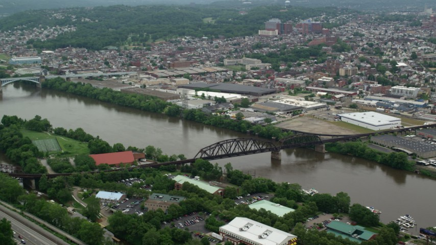 5K stock footage aerial video of a railroad bridge and riverfront warehouses, Pittsburgh, Pennsylvania Aerial Stock Footage | AX105_143