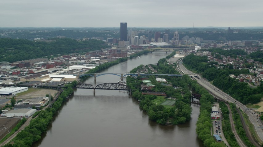 5K stock footage aerial video of a river and skyscrapers, Downtown Pittsburgh, Pennsylvania Aerial Stock Footage | AX105_146