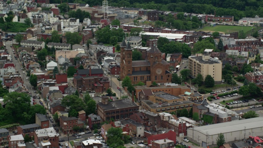 5K stock footage aerial video orbiting Our Lady of the Angels Parish Church, Pittsburgh, Pennsylvania Aerial Stock Footage | AX105_147