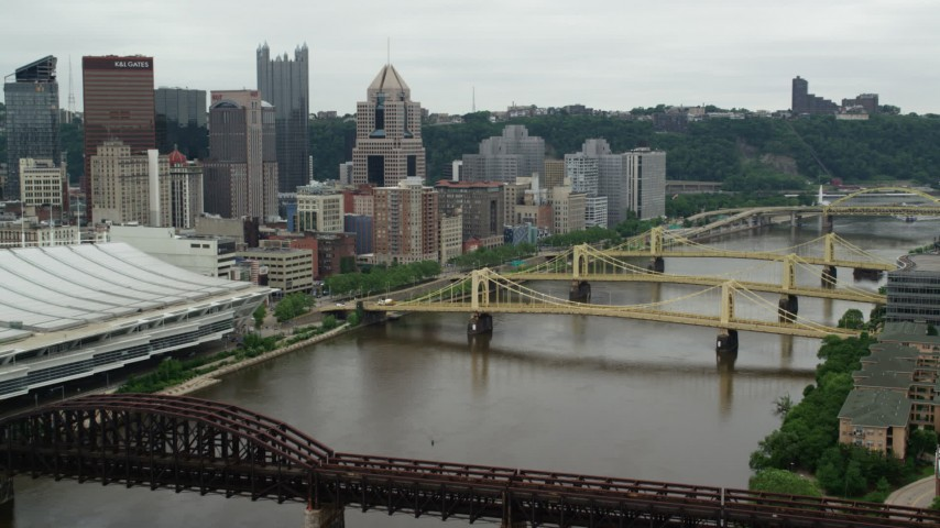 5K stock footage aerial video of bridges spanning river, Downtown Pittsburgh, Pennsylvania Aerial Stock Footage | AX105_153