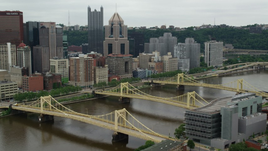 5K stock footage aerial video orbiting bridges and skyscrapers, Downtown Pittsburgh, Pennsylvania Aerial Stock Footage   AX105_154