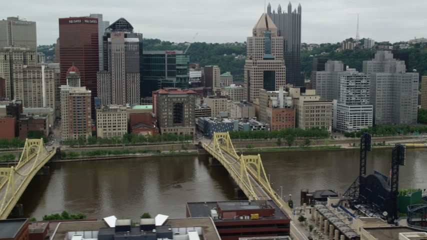 5K stock footage aerial video flying by PNC Park and Riverfront Skyscrapers, Downtown Pittsburgh, Pennsylvania Aerial Stock Footage | AX105_155