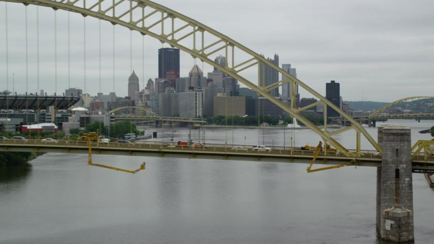 5K stock footage aerial video flying over bridge toward skyline, Downtown Pittsburgh, Pennsylvania Aerial Stock Footage   AX105_160