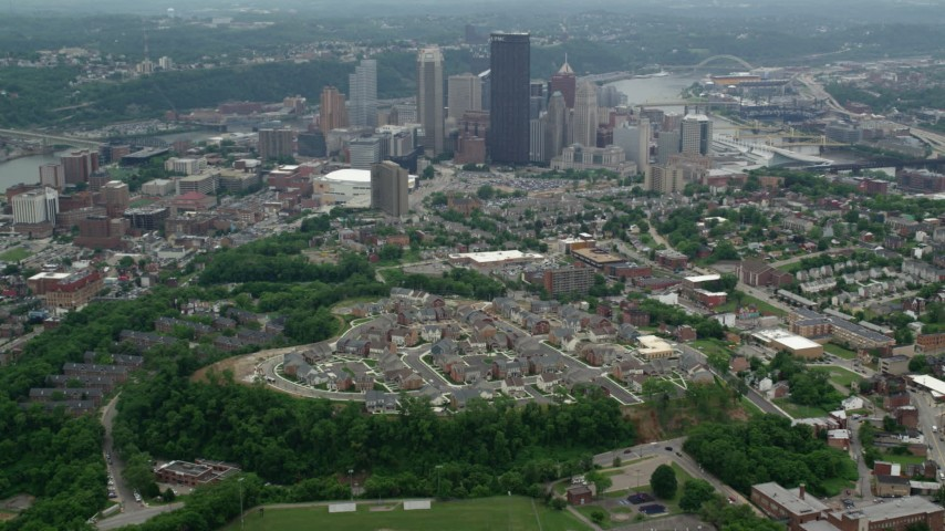 5K stock footage aerial video flying over suburbs toward Downtown Pittsburgh, Pennsylvania Aerial Stock Footage | AX105_179